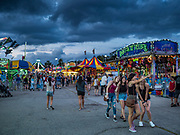 14 AUGUST 2019 - DES MOINES, IOWA: Teenagers take selfies as they leave the Midway at the Iowa State Fair. The Iowa State Fair is one of the largest state fairs in the U.S. More than one million people usually visit the fair during its ten day run. The 2019 fair run from August 8 to 18.                PHOTO BY JACK KURTZ