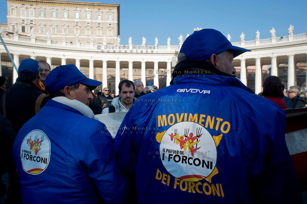 "Roma 22 Dicembre 2013<br /> Il Movimento dei forconi  siciliani di Mariano Ferro si sono dati appuntamento in Vaticano per partecipare all'Angelus e  per ascoltare le parole di Papa Francesco.<br /> Rome, Italy. 22th December 2013 -- The pitchforks movement of the  Sicily of   Mariano Ferro, went to the Vatican to attend the Angelus and to listen to the words of Pope Francis.. -- The so-called ""Pitchfork Movement"" which inspired the protest was originally a group of Sicilian farmers pushing for more help from the government, but it has grown into."