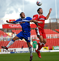 Photo: Ed Godden.<br />Swindon Town v Stockport County. Coca Cola League 2. 26/08/2006. Lee Peacock (R) is challenged by Stockport's Michael Bowler.