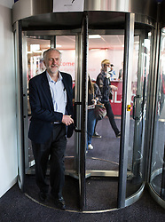 © Licensed to London News Pictures . 30/09/2015 . Brighton , UK . Labour Party Leader JEREMY CORBYN walking through revolving doors at the conference venue this morning ( Wednesday 30th September 2015 ) . The 2015 Labour Party Conference . Photo credit : Joel Goodman/LNP