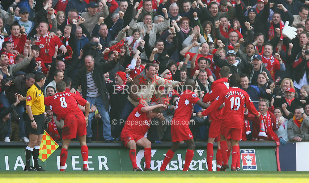 LIVERPOOL, ENGLAND - SATURDAY, FEBRUARY 18th, 2006: Liverpool players celebrate Peter Crouch's match-winning goal with their fans during the FA Cup 5th Round match against Manchester United at Anfield. (Pic by David Rawcliffe/Propaganda)