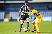Sheffield Wednesday defender Liam Palmer (2) plays the ball whilst under pressure from Preston North End forward Tom Barkhuizen (29) during the EFL Sky Bet Championship match between Sheffield Wednesday and Preston North End at Hillsborough, Sheffield, England on 22 December 2018.