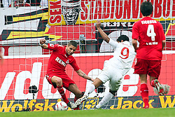 13.02.2010,  Rhein Energie Stadion, Koeln, GER, 1.FBL, FC Koeln vs Mainz 05, 22. Spieltag, im Bild: Szene zum 1:1 durch Sami Allagui (Mainz #9) (re.) gegen Youssef Mohamad (Koeln #3)  EXPA Pictures © 2011, PhotoCredit: EXPA/ nph/  Mueller       ****** out of GER / SWE / CRO  / BEL ******