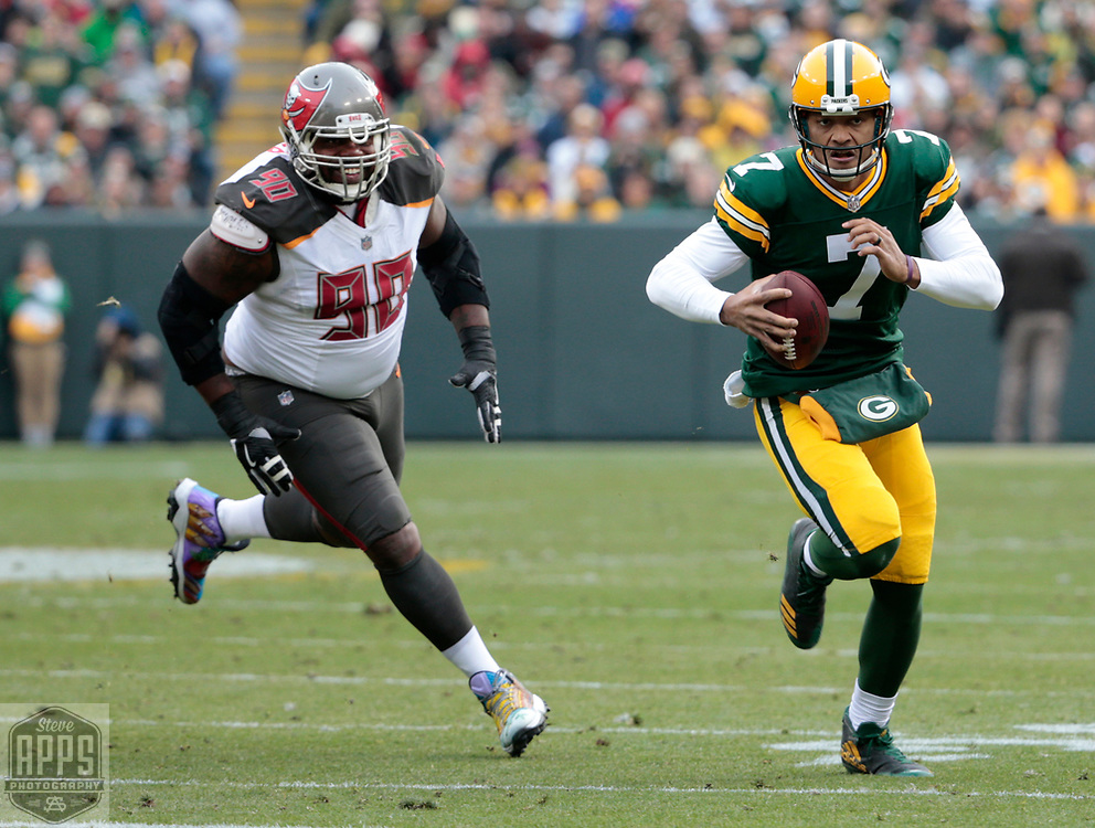 Tampa Bay Buccaneers defensive tackle Chris Baker (90) chasing after Green Bay Packers quarterback Brett Hundley (7) during a 14-yard scramble in the 2nd quarter. <br /> The Green Bay Packers hosted the Tampa Bay Buccaneers at Lambeau Field in Green Bay,  Sunday, Dec. 3, 2017.  STEVE APPS FOR THE STATE JOURNAL.