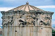 In the Roman Agora of Athens, Greece, the octagonal  Tower of the Winds was designed by Syrian astronomer Andronicus around 50 BC, with sundial, water clock, and compass. It was topped in antiquity by a weathervane-like Triton to show wind direction. This ancient horologion (timepiece) building is made of Pentelic Marble, with its frieze decorated with relief sculptures of the eight wind deities: Boreas (N), Kaikias (NE), Eurus (E), Apeliotes (SE), Notus (S), Livas (SW), Zephyrus (W), and Skiron (NW).