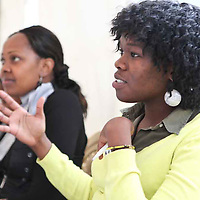 "A participant of the Fall 2011 Network of Young Women Leaders (NoYWL) ""Answer the Call to Lead"" training engages a guest speaker with questions."