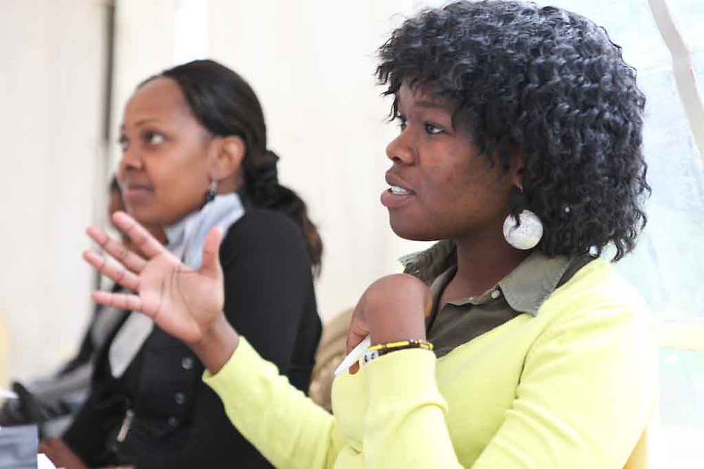 """A participant of the Fall 2011 Network of Young Women Leaders (NoYWL) """"Answer the Call to Lead"""" training engages a guest speaker with questions."""