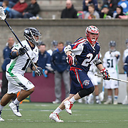 Chris Eck #24 of the Boston Cannons keeps the ball from Alex Smith #11 of the Chesapeake Bayhawks during the game at Harvard Stadium on April 27, 2014 in Boston, Massachusetts. (Photo by Elan Kawesch)