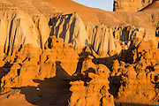 Sunrise in the Campground at Goblin Valley State Park, San Rafael Swell, Utah, USA. Admire fanciful hoodoos, mushroom shapes, and rock pinnacles in Goblin Valley State Park, in Emery County between the towns of Green River and Hanksville, in central Utah. The Goblin rocks eroded from Entrada Sandstone, which is comprised of alternating layers of sandstone (cross-bedded by former tides), siltstone, and shale debris which were eroded from former highlands and redeposited in beds on a former tidal flat.
