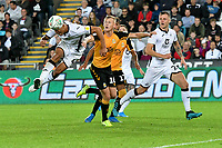 Football - 2019 / 2020 EFL Carabao (League) Cup - Second Round: Swansea City vs. Cambridge United<br /> <br /> Ben Cabango of Swansea City heads at goal, at Liberty Stadium.<br /> <br /> COLORSPORT/WINSTON BYNORTH