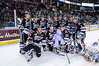 KELOWNA, CANADA - DECEMBER 5: The Kelowna Rockets pose for a photo on the ice after the annual teddy bear toss against the Portland Winterhawks on December 5, 2015 at Prospera Place in Kelowna, British Columbia, Canada.  (Photo by Marissa Baecker/Shoot the Breeze)  *** Local Caption *** Teddy Bear;
