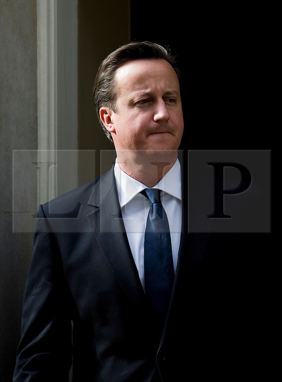 © Licensed to London News Pictures. 16/05/2012. London, UK. British Prime Minister David Cameron greeting Qatar Prime Minister Hamad bin Jassim bin Jaber Al Thani on the steps of 10 Downing Street on May 15, 2012.  Photo credit : Ben Cawthra/LNP