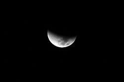"""28.09.2015, Rafah, PSE, Supermond, Mondfinsternis und Blutmond, im Bild Naturschauspiel - Supermond, Blutmond und Mondfinsternis in einer Nacht. // A supermoon is pictured at the beginning of a total lunar eclipse above Rafah in southern Gaza strip, September 28, 2015. Sky-watchers around the world are in for a treat Sunday night and Monday when the shadow of Earth casts a reddish glow on the moon, the result of rare combination of an eclipse with the closest full moon of the year. The total """"supermoon"""" lunar eclipse, also known as a """"blood moon"""" is one that appears bigger and brighter than usual as it reaches the point in its orbit that is closest to Earth, Palestine on 2015/09/28. EXPA Pictures © 2015, PhotoCredit: EXPA/ APAimages/ Abed Rahim Khatib<br /> <br /> *****ATTENTION - for AUT, GER, SUI, ITA, POL, CRO, SRB only*****"""