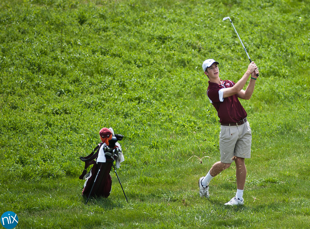 Robinson's Trevor Cone hits from the fairway during the South Piedmont Conference golf tournament at the Rocky River Golf Club in Concord Monday afternoon. (Photo by James Nix)