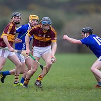 Tulla's David McInerney takes the ball ahead of Kilmaley's Michael O'Malley
