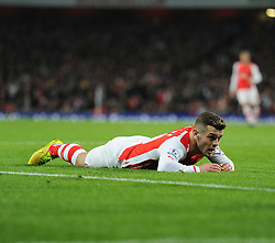 Arsenal's Jack Wilshere lays looking dejected on the floor. - Photo mandatory by-line: Alex James/JMP - Mobile: 07966 386802 - 22/11/2014 - Sport - Football - London - Emirates Stadium - Arsenal v Manchester United - Barclays Premier League