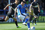 Ian Henderson shoots during the EFL Sky Bet League 1 match between Rochdale and Bury at Spotland, Rochdale, England on 26 August 2017. Photo by Daniel Youngs.