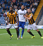 Anthony Grant, Carl Dickinson and burys Leon Clarke tussle in the box during the Sky Bet League 1 match between Bury and Port Vale at Gigg Lane, Bury, England on 19 September 2015. Photo by Mark Pollitt.