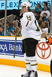 March 5, 2011; San Jose, CA, USA;  Dallas Stars left wing Jamie Benn (14) celebrates after scoring a short handed goal against the San Jose Sharks during the first period at HP Pavilion. Mandatory Credit: Jason O. Watson / US PRESSWIRE