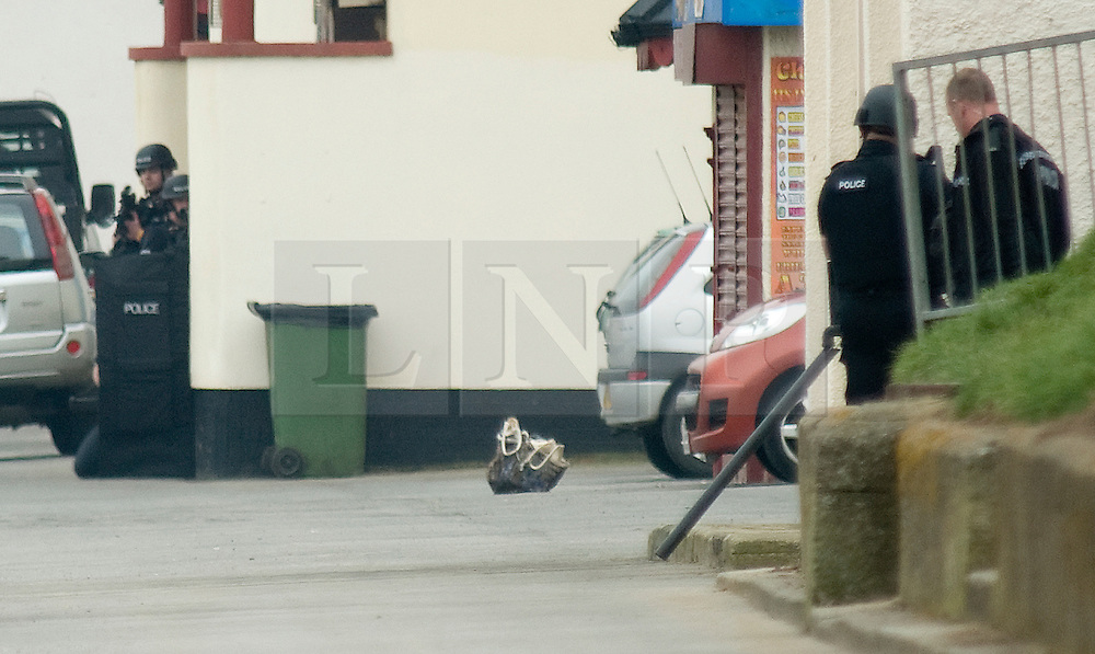 © Licensed to London News Pictures. 13/03/2012. Saltburn, England. Armed police watch over a bag left on the ground which is suspected of carrying a bomb. Armed Police today (13/02/2012) surround a person (NOT IN PICTURE), believed to be a woman, suspected of carrying a bomb in a bag on the seafront at Saltburn, Cleveland. Photo credit : Ian Forsyth/LNP