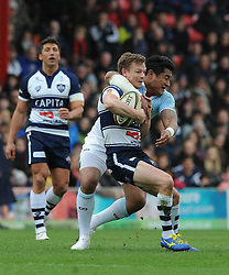 Bristol Rugby Scrum-Half Dwayne Peel (capt) is challenged by Bedford Blues Inside Centre Viliami Hakalo - Photo mandatory by-line: Dougie Allward/JMP - Mobile: 07966 386802 - 29/03/2015 - SPORT - Rugby - Bristol - Ashton Gate - Bristol Rugby v Bedford Blues - Greene King IPA Championship