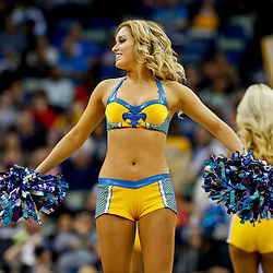 Mar 25, 2013; New Orleans, LA, USA; New Orleans Hornets Honeybees dance team performs during the second half of a game against the Denver Nuggets at the New Orleans Arena. The Hornets defeated the Nuggets 110-86. Mandatory Credit: Derick E. Hingle-USA TODAY Sports