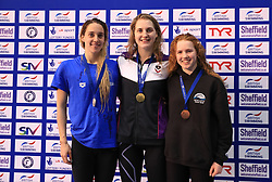 The medal ceremony for the Women's 200m Butterfly, gold medalist Charlotte Atkinson (centre), silver medalist Alys Thomas (left) and bronze medalist Emily Large during day three of the 2017 British Swimming Championships at Ponds Forge, Sheffield.
