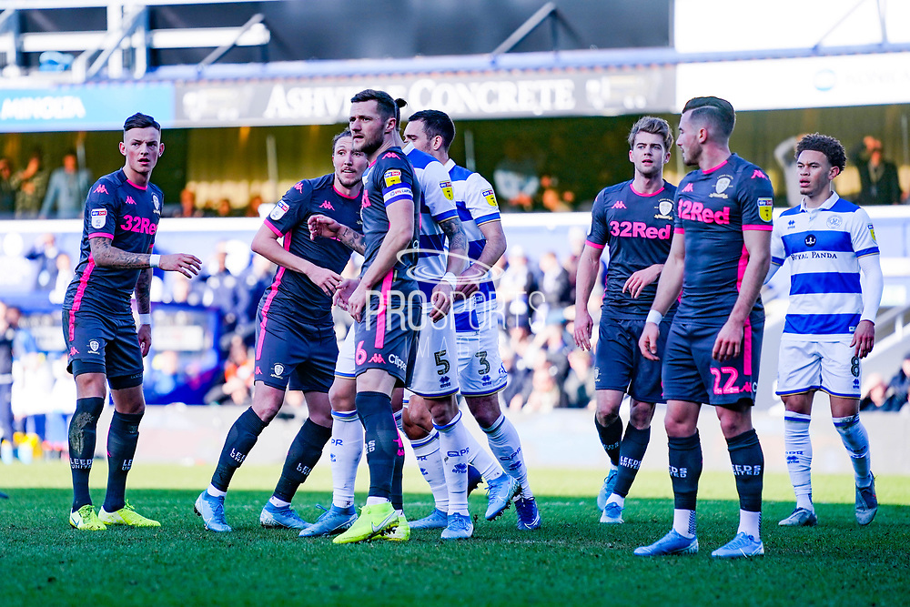 Leeds United defender Liam Cooper (6) and Leeds United defender Ben White (5) in action during the EFL Sky Bet Championship match between Queens Park Rangers and Leeds United at the Kiyan Prince Foundation Stadium, London, England on 18 January 2020.