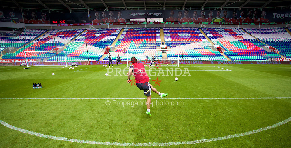 CARDIFF, WALES - Thursday, June 11, 2015: Wales' Gareth Bale shoots in front of a Cymru mosaic during a training session at the Cardiff City Stadium ahead of the UEFA Euro 2016 Qualifying Round Group B match against Belgium. (Pic by David Rawcliffe/Propaganda)