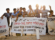 Young people who once lived in the village of Ar-Raqib demonstrating for their rights to the land and their rights to rebuild. The entire town was demolished by the Israeli government on July 27, 2010 - 67 houses destroyed, 563 people left homeless, some 4500 olive trees uprooted. After that, bulldozers returned every week to demolish any attempts at rebuilding.