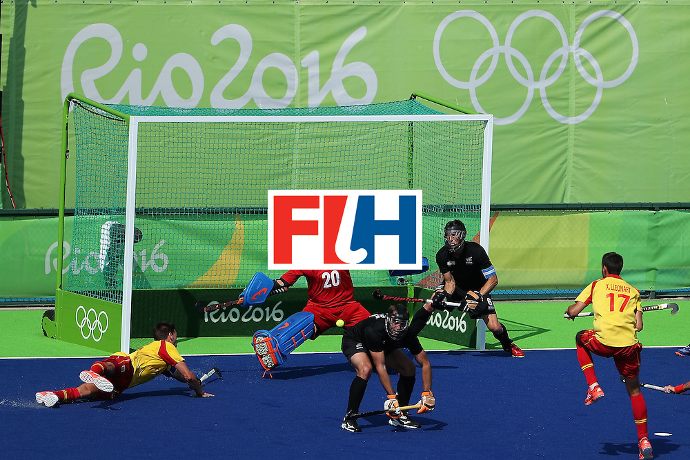 RIO DE JANEIRO, BRAZIL - AUGUST 09:  Goalkeeper Devon Manchester #20 of New Zealand makes a save on a shot attempt from Manel Terraza #22 of Spain duuring the hockey game on Day 4 of the Rio 2016 Olympic Games at the Olympic Hockey Centre on August 9, 2016 in Rio de Janeiro, Brazil.  (Photo by Christian Petersen/Getty Images)