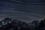 Light trails of climbers and star trails of the milky way over Mont Blanc, Chamoinx, France, long time exposure and photo stacking<br /> <br /> Impressionen beim Refuge du Couvercle am Fuss der Aiguille Verte über dem Mer de Glace an einem sehr schönen Herbsttag im September