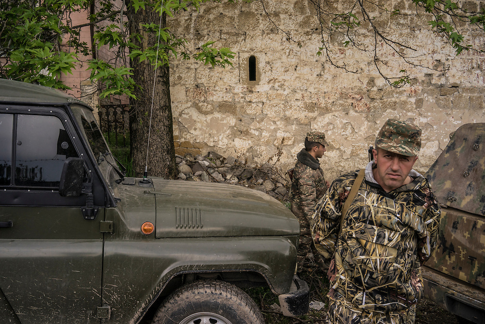 Soldiers from the Nagorno-Karabakh armed forces outside the Church of Mother Mary on Sunday, May 8, 2016 in Talish, Nagorno-Karabakh. Due to intense nearby fighting in early April, the entire village has been evacuated of civilians.