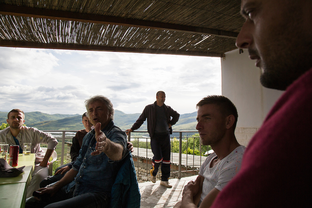 Ulrich Eichelmann, founder of River Watch, a non-governmental organization working to preserve and save undammed rivers from hydropower projects talks with villagers from Kuta about legal options to stopping the damming of the Vjosa River.