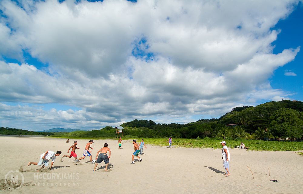 Pickup game of beach soccer on the beach of Tamarindo in Costa Rica