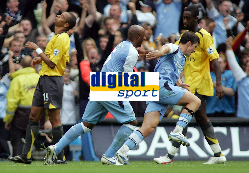 Photo: Paul Thomas.<br /> Manchester City v Arsenal. The Barclays Premiership. 26/08/2006.<br /> <br /> Joey Barton (3rd L) of Man City celebrates his goal with Ousmane Dabo (2nd L).