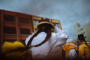 Maria Eugenia Herrera Mamani, alias &ldquo;Claudina The Cursed&rdquo;, dances during the carnival in El Alto, Bolivia, February 18, 2012.<br /> <br /> En la ciudad de El Alto - ciudad vecina con La Paz, Bolivia- situada a una altura de 4,000 msnm, turistas y gente local hacen fila para comprar boletos para presenciar el espect&aacute;culo de las cholitas luchadoras.  Cada domingo un grupo de mujeres, las &ldquo;cholitas&rdquo;, se prepara para dar un espect&aacute;culo de lucha libre. Ellas portan la ropa tradicional de las mujeres Aymaras, que se ha mantenido desde la &eacute;poca colonial. Su atuendo consiste en faldas amplias, bombines -sombrero t&iacute;pico-, zapatos de pl&aacute;stico, trenzas hasta la cintura, joyas de gran tama&ntilde;o, maquillaje y chales bordados.<br /> Yenny Wilma Maraz, conocida como &ldquo;Marta La Alte&ntilde;a&rdquo;, saluda al p&uacute;blico con los brazos extendidos bailando al ritmo de la m&uacute;sica, entrega su chal y su sombrero para subir al ring. Sube orgullosa a&uacute;n siendo abucheada por el p&uacute;blico. Ella es ruda y tendr&aacute; que pelear contra los buenos.<br /> La lucha libre es un espect&aacute;culo teatral, pero tambi&eacute;n requiere de un enorme esfuerzo f&iacute;sico y de entrenamiento constante para poder realizar vuelos desde las cuerdas del ring y soportar las ca&iacute;das, que muchas veces son dolorosas.<br /> Los eventos de lucha libre son un negocio cada vez mayor. Cientos de turistas y bolivianos, asisten cada semana para ver a las cholitas vencer a sus adversarios. Las cholitas como otros luchadores pertenecen a grupos manejados por diferentes m&aacute;nager, quienes en muchas ocasiones sacan ventaja, llev&aacute;ndose gran parte de las ganancias y dejando a ellas con casi nada. Esto ha creado divisiones, y por lo tanto, se han conformado nuevos grupos tales como Las Diosas del Ring, quienes ofrecen su espect&aacute;culo en diferentes puntos de la ciudad. La lucha libre boliviana ha ganado popula