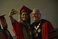 Student takes a selfie with Chancellor Woodson during the procession into PNC.