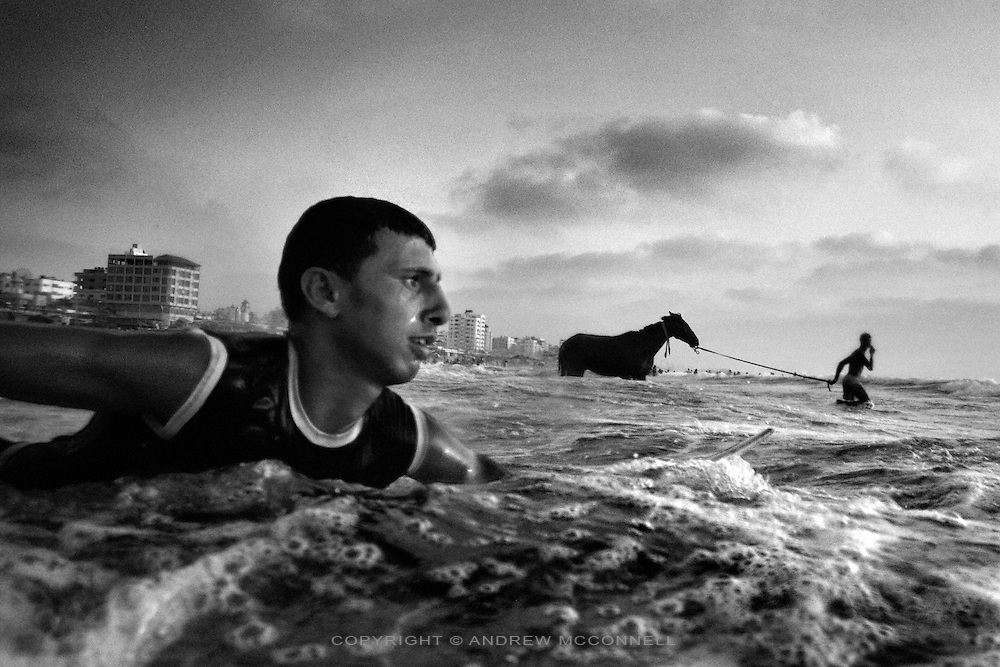 Amer Al Dous, 16, paddles out to sea from Gaza City, in the Gaza Strip. Leaving Gaza has become extremely difficult since the Israeli blockade began in 2007.