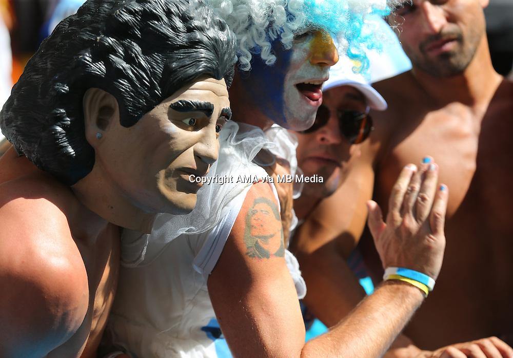 A fan of Argentina wearing a Diego Maradona mask alongside a fan with a Maradona tattoo