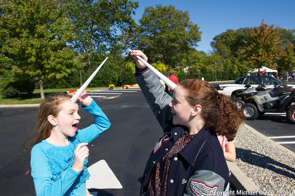 15 Oct. 2016 Forked River USA / Kealy and DanaRose use the cotton candy sticks to become unicorns as St Pius X celebrates it's 10th year in their new church with a festival open to all  /  Michael Glenn  / Glenn Images