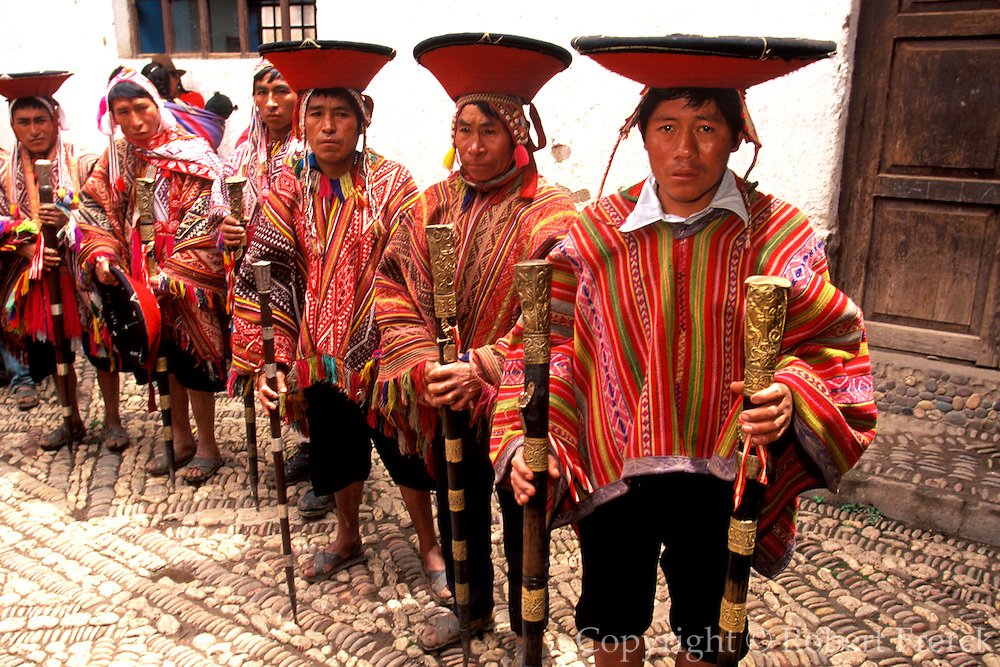 PERU, URUBAMBA VALLEY Pisac; village elders with staffs