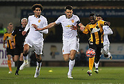 Cambridge United Sullay Kaikai battling withManchester United's Michael Carrick during the The FA Cup match between Cambridge United and Manchester United at the R Costings Abbey Stadium, Cambridge, England on 23 January 2015. Photo by Phil Duncan.