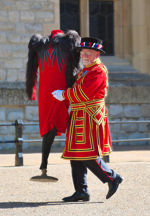 LONDON, ENGLAND - JUNE 02:  A Beefeather at the Tower of London with one of the new uniform design. The Design Museum has helped to commission fashion students to reinterpret London's most iconic  and historic uniform on June 2, 2009 in London, England.  (Photo by Marco Secchi/Getty Images)