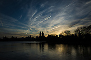 Sunset over the Reservoir in Central Park with a view of the twin towers of the El Dorado apartment building.