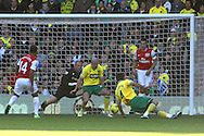 Picture by Paul Chesterton/Focus Images Ltd.  07904 640267.19/11/11.Theo Walcott of Arsenal has a shot on goal during the Barclays Premier League match at Carrow Road stadium, Norwich.