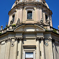 Church of Most Holy Name of Mary at Forum of Trajan in Rome, Italy<br /> A short distance away is the Church of Most Holy Name of Mary. It towers over the Column of Trajan at the Forum of Trajan. This Roman catholic church designed by architect Antoine Derizet was finished in 1741. Enshrined on the altar is an icon of the Blessed Virgin Mary. It is considered to have been painted by Luke the Evangelist. The white marble dome of Santissimo Nome di Maria al Foro Traiano is remarkably similar yet much larger than its neighbor, Santa Maria di Loreto. They were constructed 145 years apart.