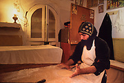 "St Antony coptic monastery, in the night the monks prepare the bread. The monastey, nestled amount the mountains near the Red sea, is the oldest and biggest of the Coptics monasteries, founded in 4th century from disciples of St Antony. Here, in this desert, is born the Christian experience of the monks and monasteries. Coptics, Greek Orthodox, Syrians, only few components of the fragmented galaxy of the ""living stones"" as often are defined the oriental christian churches, are the protagonists of a frequently forgotten world that currently menaces to die in the same places in which Christianity born. Rituals and stories similar to legends lost in time survive intact and in these places regain the strenght of a living reality."
