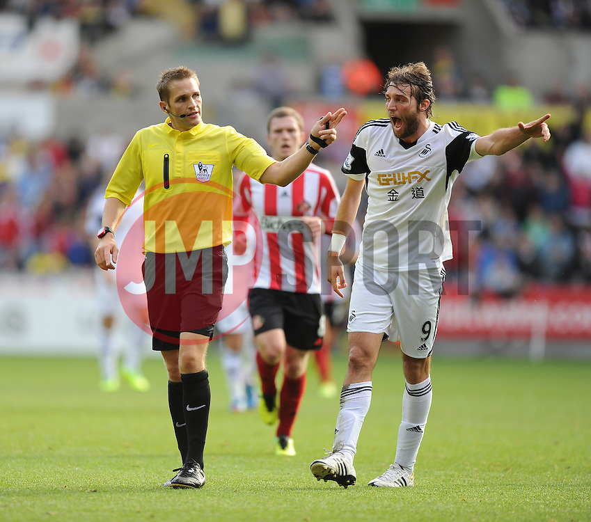 Swansea City's Michu complains to ref after a foul made just outside the box.- Photo mandatory by-line: Alex James/JMP - Tel: Mobile: 07966 386802 19/10/2013 - SPORT - FOOTBALL - Liberty Stadium - Swansea - Swansea City v Sunderland - Barclays Premier League