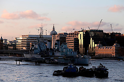 UK ENGLAND LONDON 2FEB14 - HMS Belfast lies moored on the Thames in front of the skyline of the City of London, seen from Tower Bridge .<br /> <br /> <br /> <br /> jre/Photo by Jiri Rezac<br /> <br /> <br /> <br /> © Jiri Rezac 2014